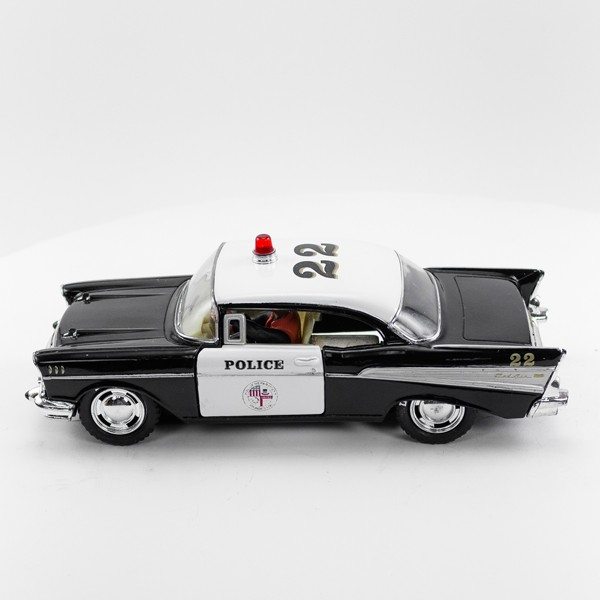 Stock Number 16173: Black Police Car 57 Chev by SCX